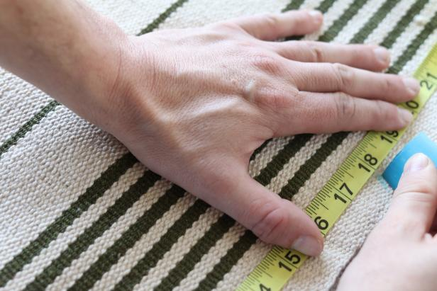 Using the length and width measurements of the pet bed as a guide, mark the rug to size using a marker or chalk.