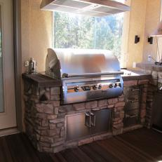 Modern Stainless Grill, Outdoor Kitchen with Stone Accents