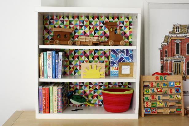 Customize A Bookshelf By Adding Colorful Accent To The Back Panel
