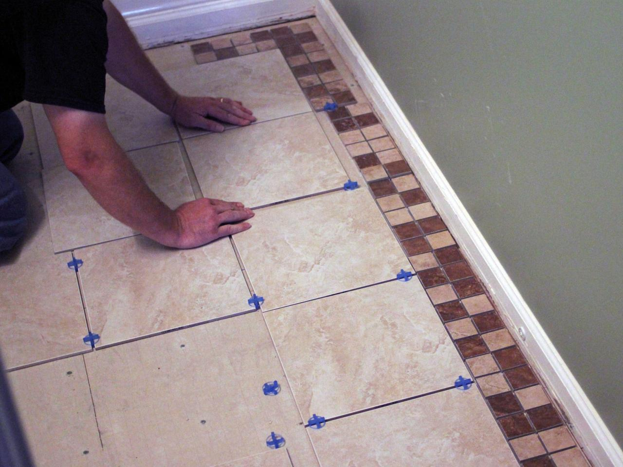 How to install bathroom floor tile how tos diy How to put tile on wall in the kitchen