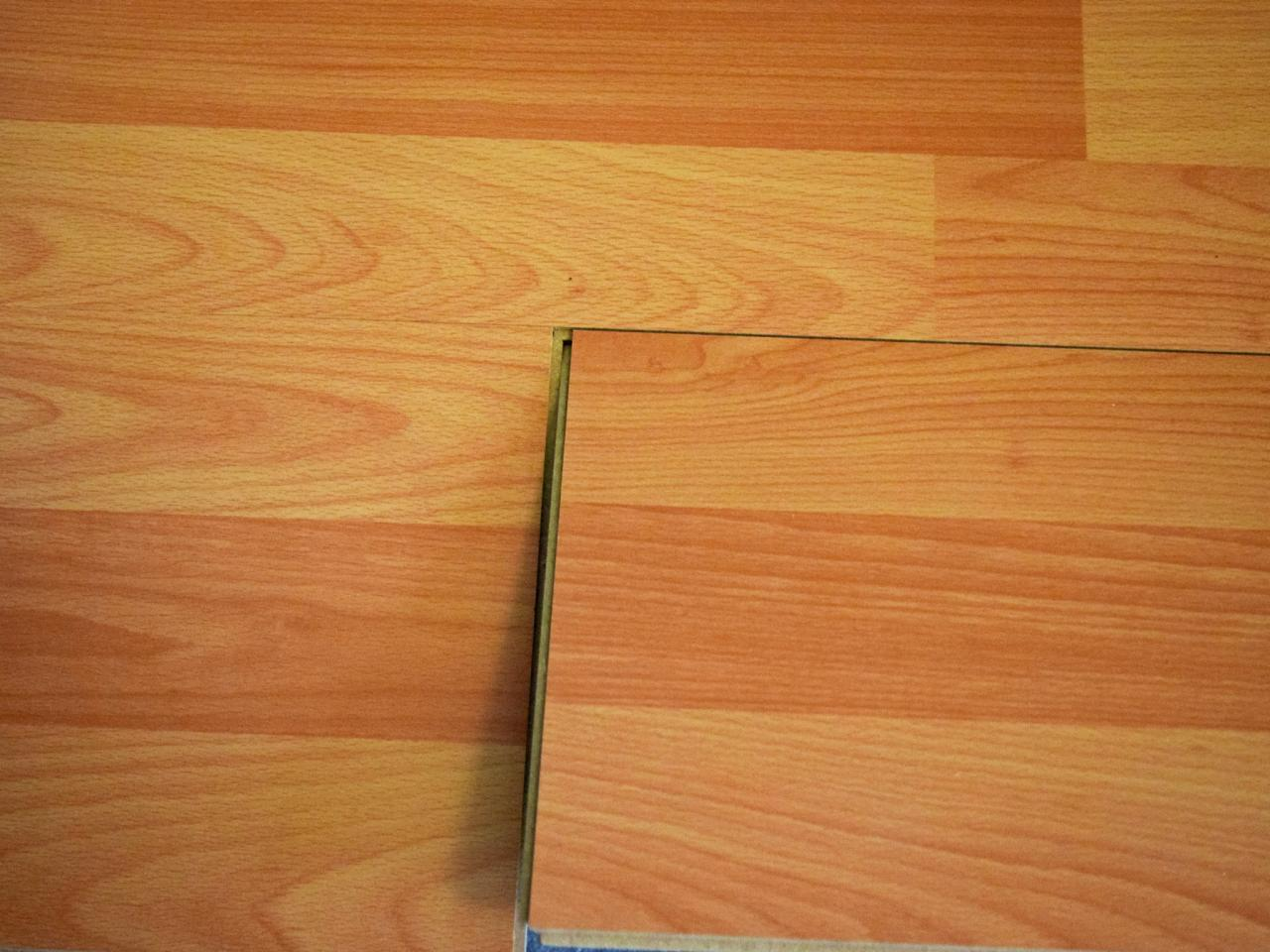 Wood laminate flooring cost square foot wood laminate for Square laminate flooring