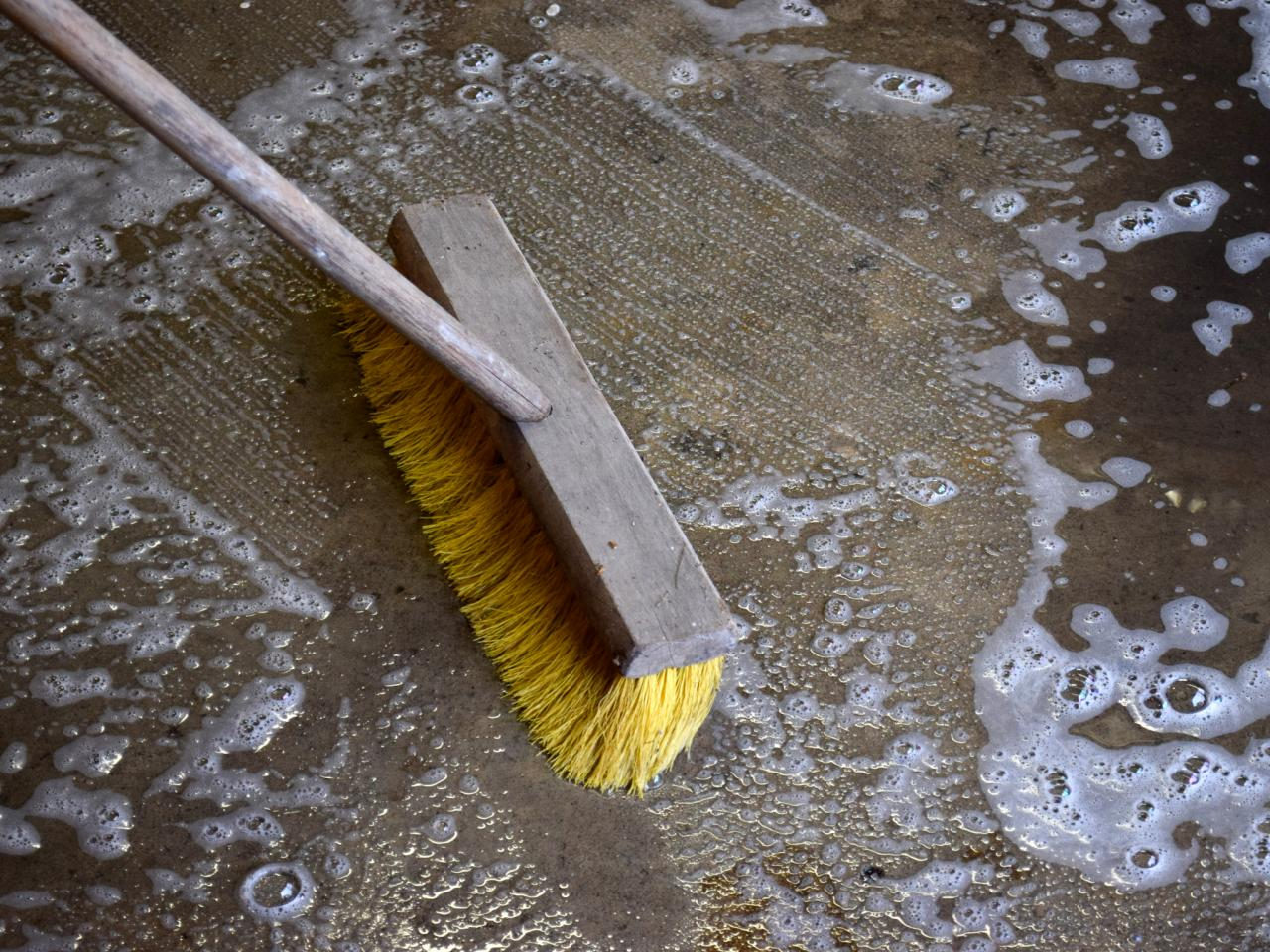 How to paint a garage floor with epoxy how tos diy for Scrubbing concrete floors
