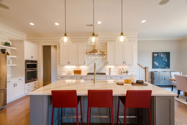 Light Transitional Kitchen with Shiplap Walls and an Island with Red Leather Barstools