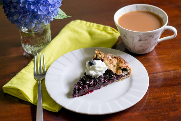 Enjoy Blueberry Crostada with Whipped Cream and a Cup of Tea
