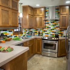 Colorful Backsplash and Concrete Coutrertops