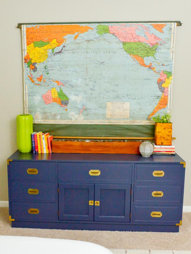 Bright World Map Reused as Decoration Above Blue Chest