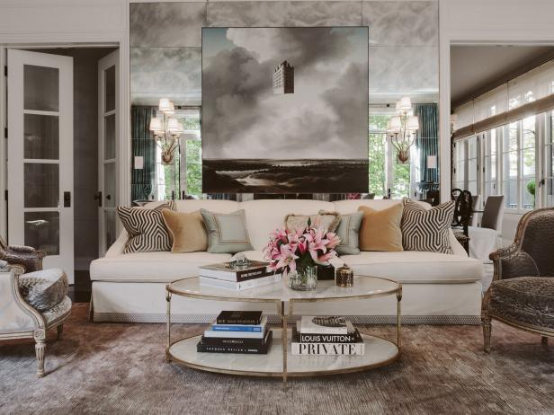 Modern Living Room with Mirrored Wall and Cream Couch