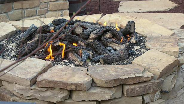 Easily build a stone fire pit video diy for How to build a fire ring with rocks