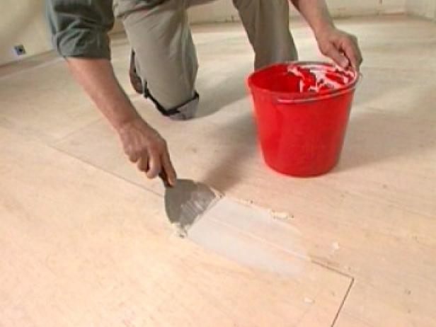 apply skim mortar over cracks in floor
