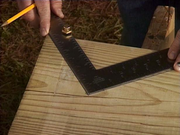 "The sides of the stairs, or stringers, are cut from 2-by-12 boards. Using a framing square, mark out the portions to be cut away from the stringer. Starting at the top corner of the board, place the square so that one leg is 7.46"" (the rise) and the other is at 10"" (the tread) ."