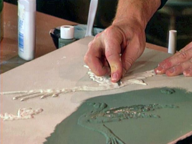 Allow plaster designs to dry, then use craft knife to carve details as desired.