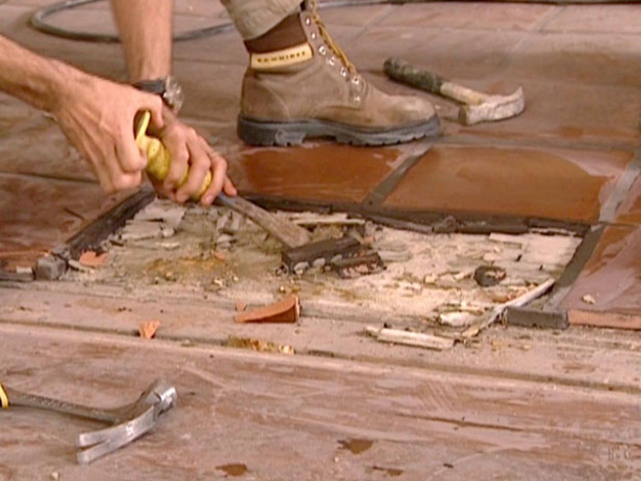 A Grinder Cuts Out Grout For Easy Tile Removal