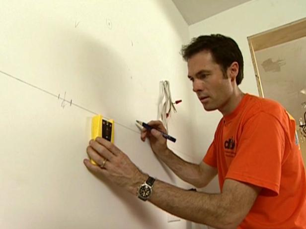 use a stud finder to locate the wall studs