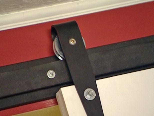 attach hanger rollers to the door
