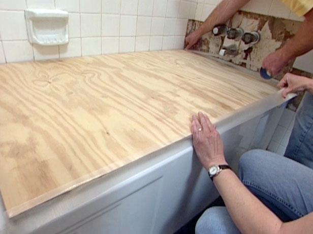 plywood prevents debris from getting into tub