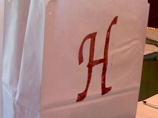 monogrammed luminaries add a personal touch
