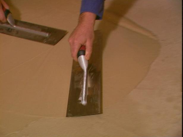 use hand trowels to spread Thin Finish