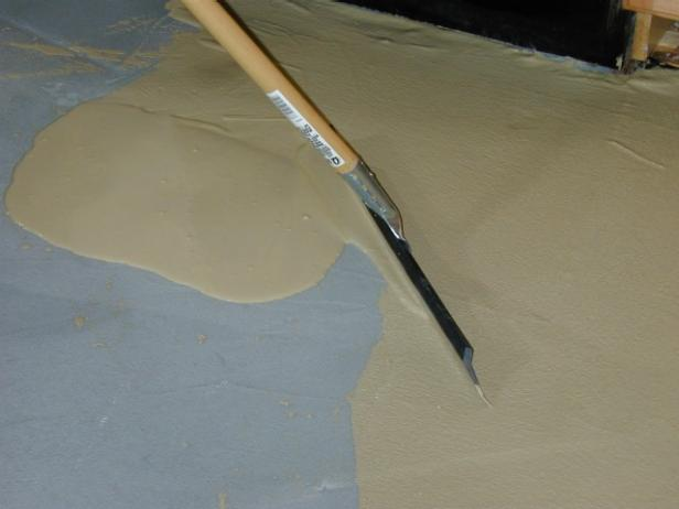spread thin finish on floor with squeegee
