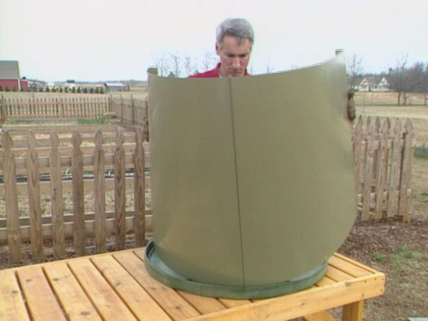 lay out parts of compost barrel to assemble