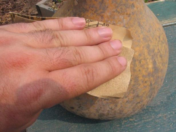 use sandpaper to smooth exterior of gourd