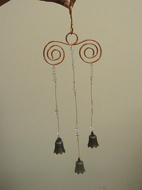 whimsical chimes made from wire,coins and beads