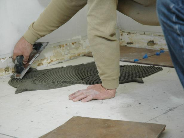 Spread thinset with the notched trowel, keeping the trowel at a 45 degree angle.
