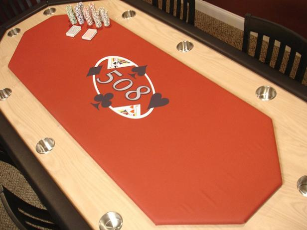 oak poker table has felt center and cup holders