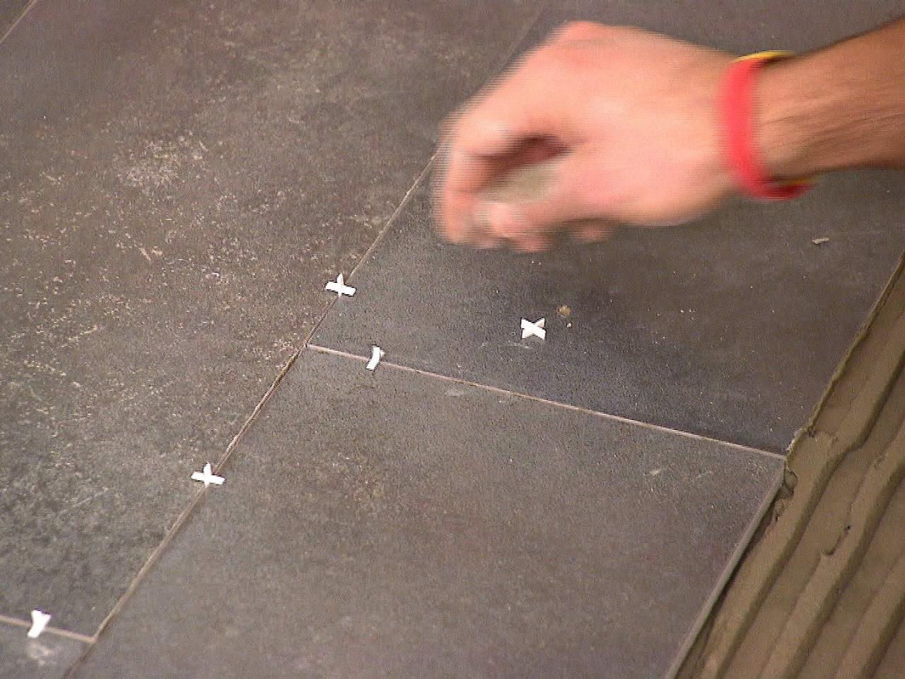 How to install a plank tile floor how tos diy step 5 dkim109plank tile floor grout spacerss4x3 dailygadgetfo Images