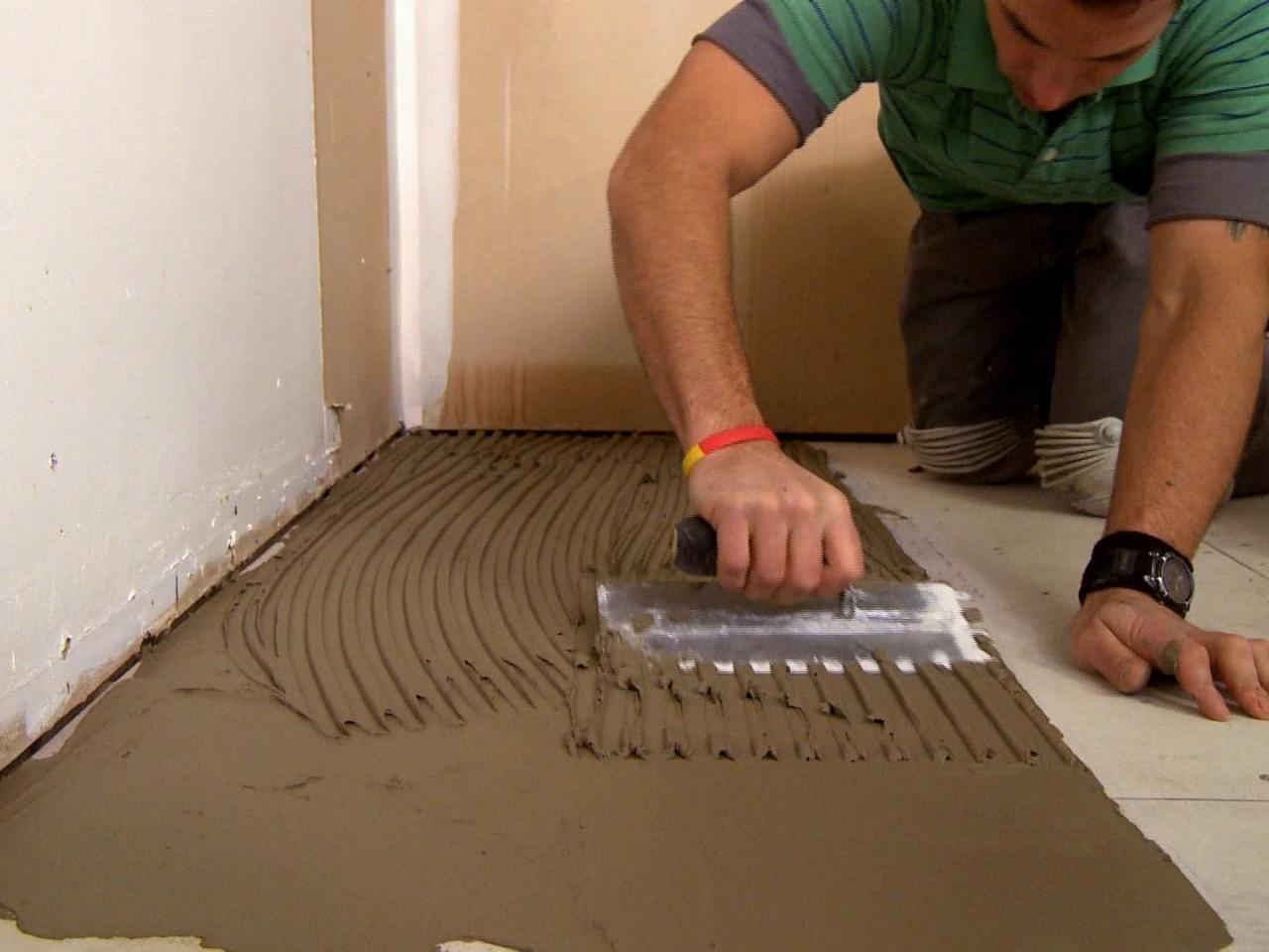 How to install a plank tile floor how tos diy dkim109plank tile floor spread mortar 1s4x3 dailygadgetfo Images