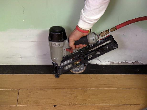 Pneumatic tools such as this nailer use compressed air to drive the fastener into position. Some compressors can only one tool at a time, while bigger models can accommodate two or three tools. The nails for pheumatic nailers are more expensive than traditional nails because they come in strips that feed into the nailer's rail assembly.