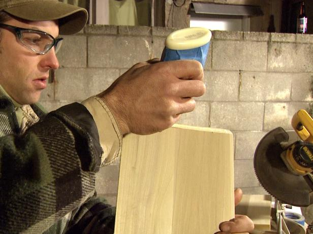 Host uses wood glue to install diagonals into the wine rack frame.