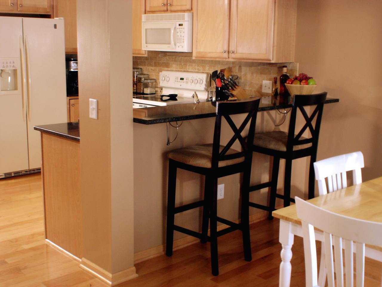 How to create a raised bar in your kitchen how tos diy for Kitchen wall island