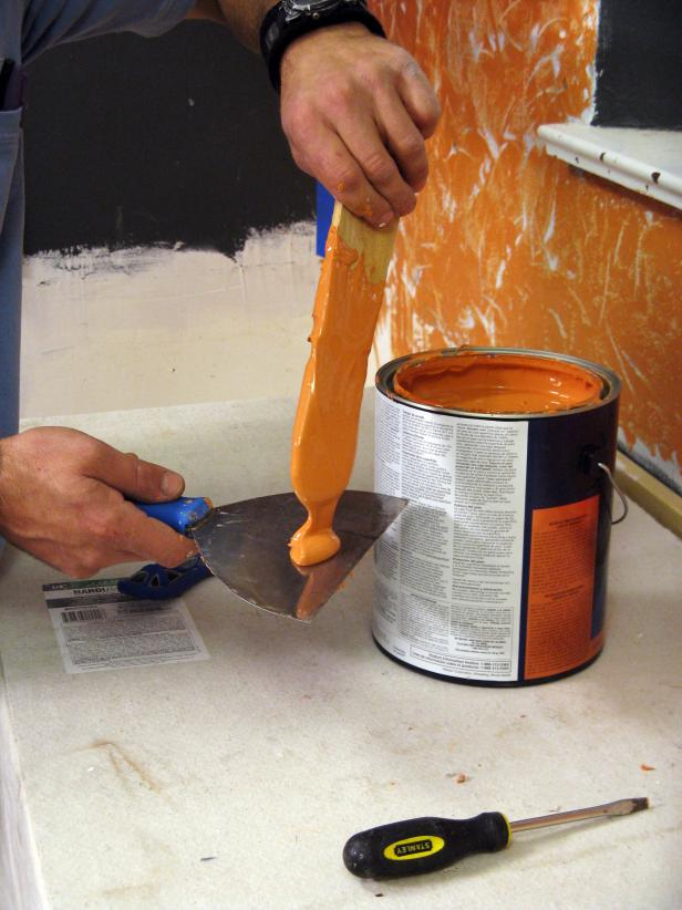 Drop a dollop of plaster on one spatula before applying to wall.