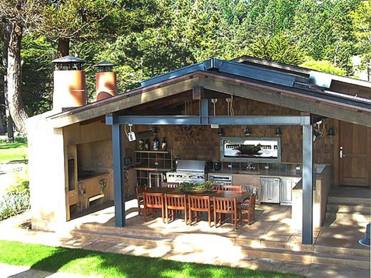 Outdoor Kitchen With Bar Seating And Sliding Glass Walls