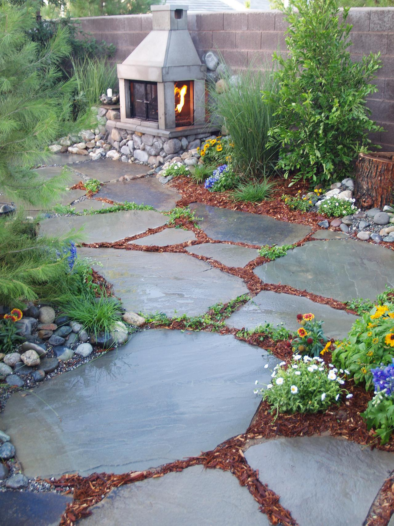 66 Fire Pit and Outdoor Fireplace Ideas | DIY Network Blog: Made + Easy Backyard Walkway Ideas on cheap backyard ideas, backyard court ideas, small back yard landscaping ideas, backyard umbrella ideas, backyard steps ideas, backyard deck ideas, backyard bathroom ideas, backyard river ideas, backyard concrete ideas, backyard patio ideas, backyard landscaping ideas, backyard brick ideas, backyard block ideas, backyard water ideas, backyard entryway ideas, backyard wood ideas, backyard platform ideas, backyard pier ideas, backyard garden walkways, backyard passage ideas,