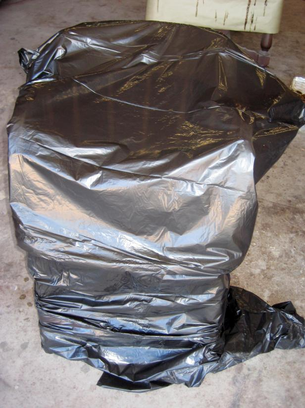 Another method is to apply stripper to the chair, then quickly cover the entire chair with a large garbage bag. This traps in the chemicals and allows the stripper to work more effectively.