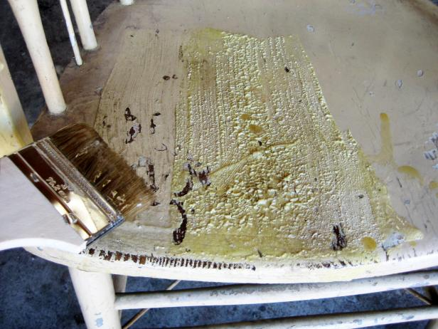 Apply stripper to all painted surfaces with a chip brush – we used an old cooking pot as a reservoir for the stripper.