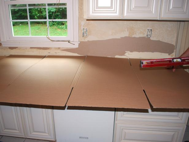 Use cardboard or other thin, cheap material to create your template for your granite countertop. In your template, you must measure the exact locations of cutouts for sinks and cooktops, and holes for faucets and soap dispensers.