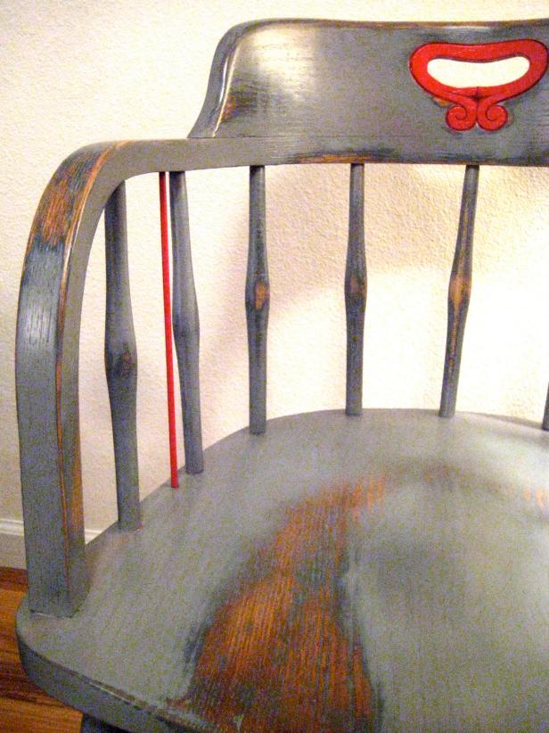 A detail photo of your completed chair after applying 3 to 5 coats of a clear protective finish. Let dry adequately before use. Note the distressed/worn areas.
