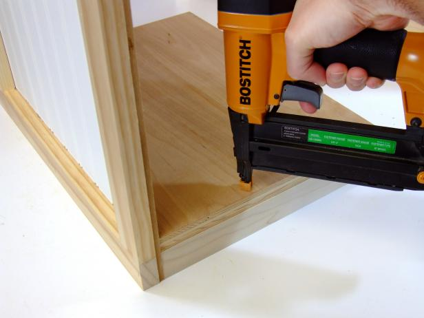 Position the door shelf centered on the shelf rail/stile assembly and flush against the door panel and attach using glue and #18 x 1-1/4-inch brads as shown in Image 3.