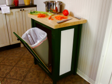 Hide your trash can in style with this tilt-open-door cabinet. You can add any countertop to it; we choose butcher block to have an extra food prep area.