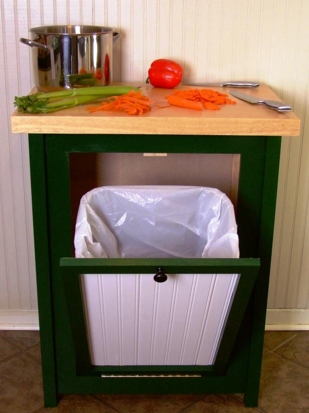 Hide your trash can in style with this tilt-open-door cabinet.
