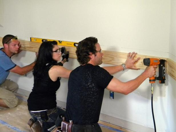 Start from one end of the wall or door trim and attach the top rail using a finish nail gun to secure the first section of top rail, hitting the marked wall studs. This end section, which is usually against a wall or door trim, uses a 90-degree cut, or square cut with the miter saw.
