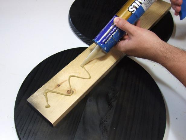Apply construction adhesive to the unpainted face of the base and attach using #18 x 1-inch wire brads.