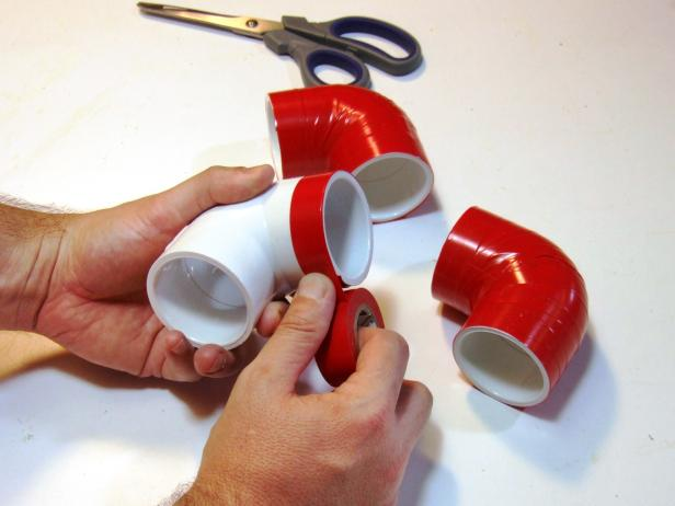Cut 20 legs from PVC pipes per the project parts list using either a miter saw or a hack saw. Wrap the 90-degree elbows and 45-degree elbows with red electrical tape.