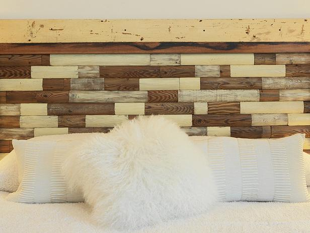 This rustic, chic headboard was made from a section of an old picket fence. The pickets were cut up into small pieces, cleaned and then refinished in a few different ways. Then the pieces were fitted into a frame made from more weathered lumber.