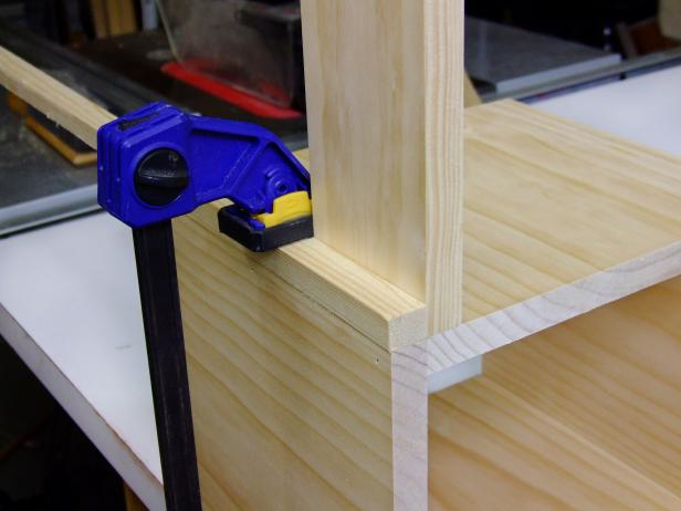 Attach feet rails using glue. Clamp a 3/4-inch piece of scrap to the assembly to help with the offset spacing. Repeat to create a second assembly.