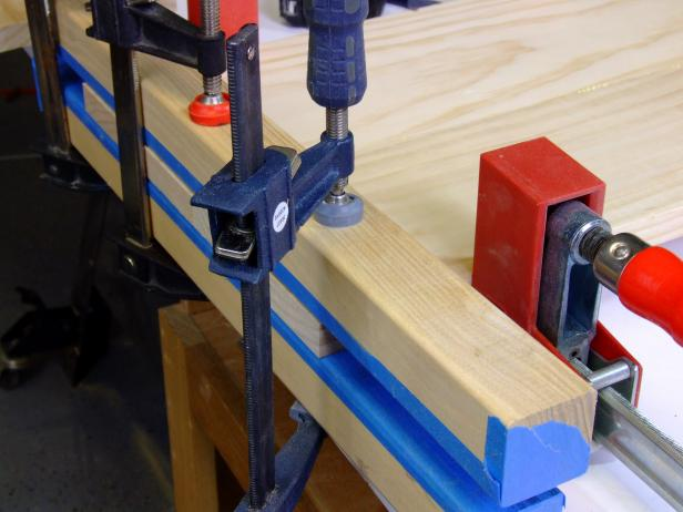 Position clamping cauls against the headboard panels and butted against the bar clamps, and clamp lightly in place.