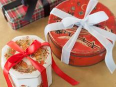 Vintage tin containers have become collectible pieces, and when used as holiday wrapping, they become a memorable part of the gift itself.