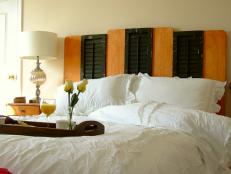 Pair salvaged building materials with new lumber to create a shabby-chic headboard.